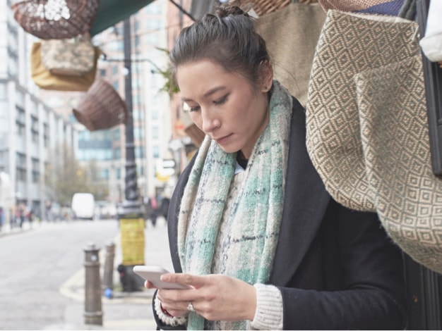 image of person using the app on a mobile